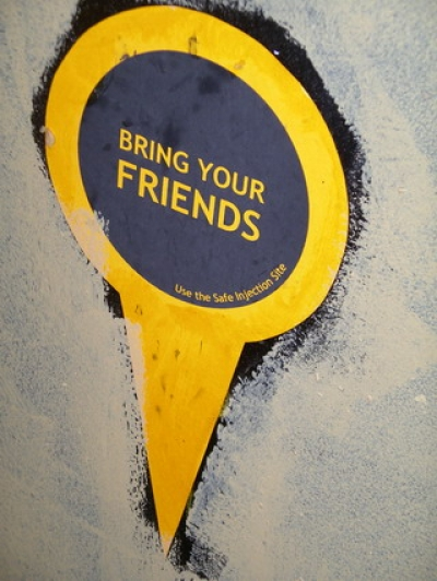 sign at insite: bring your friends
