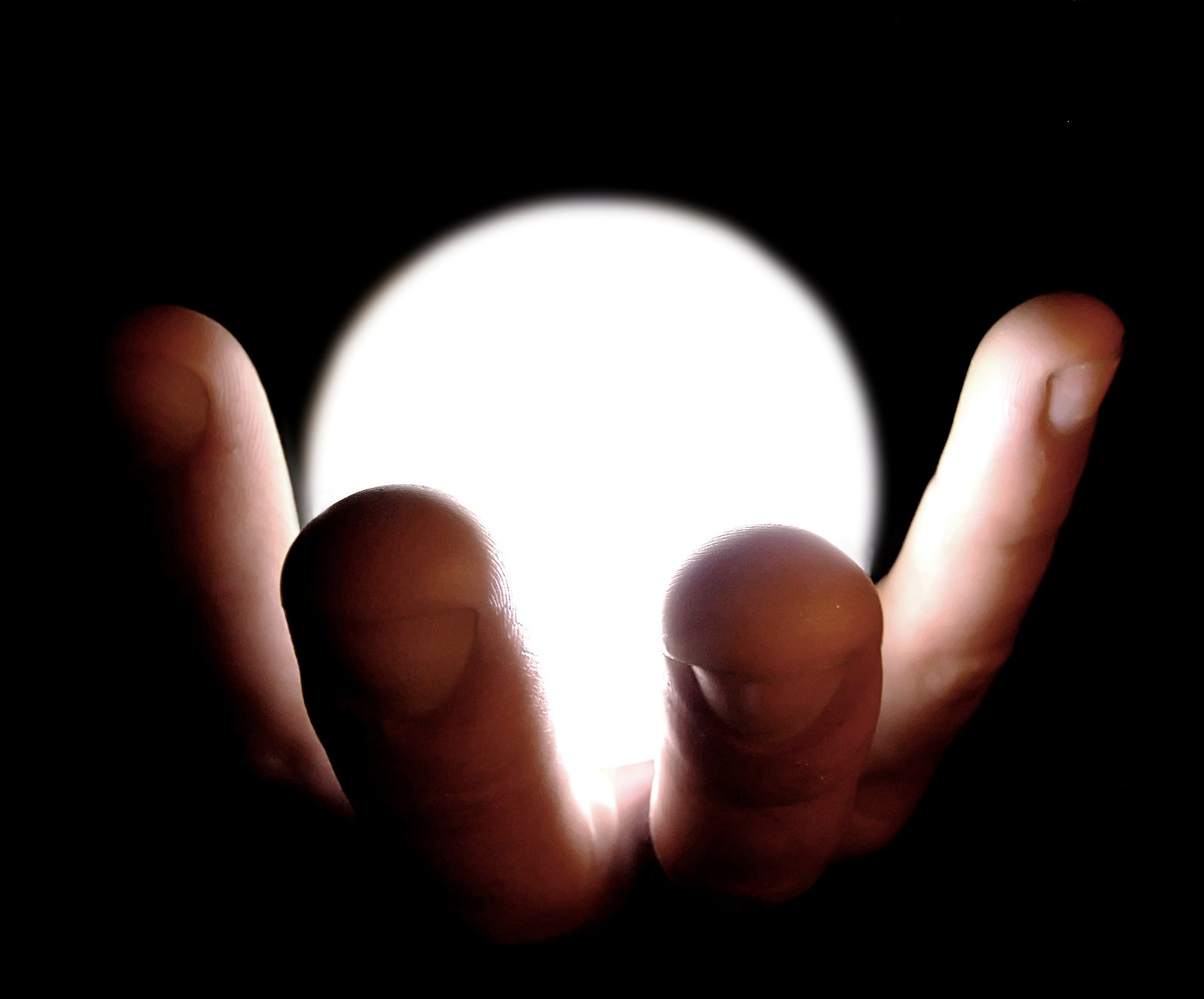 light bulb in a human hand - but lit up!