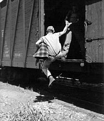 a man hopping a freight train