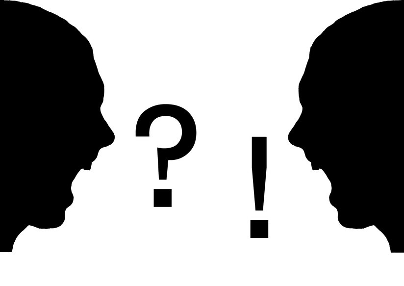 two silhouetted faces involved in a heated discussion