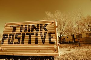Think Positive billboard in a desert
