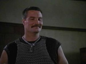 the mustachioed villain in commando