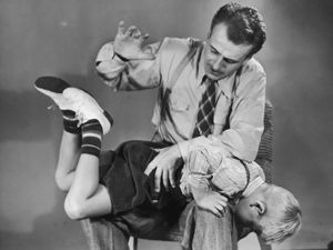 a parent administering a spanking